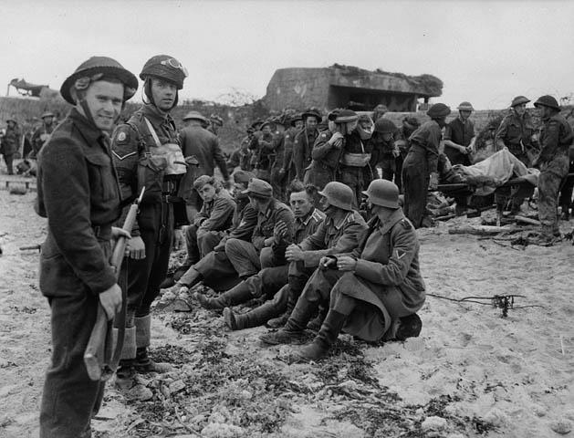 <p>Photographer: Dubervill, Frank L.<br /> Location: Normandy, France<br /> Date: June 6, 1944.<br /> Credit: Library and Archives Canada </p>