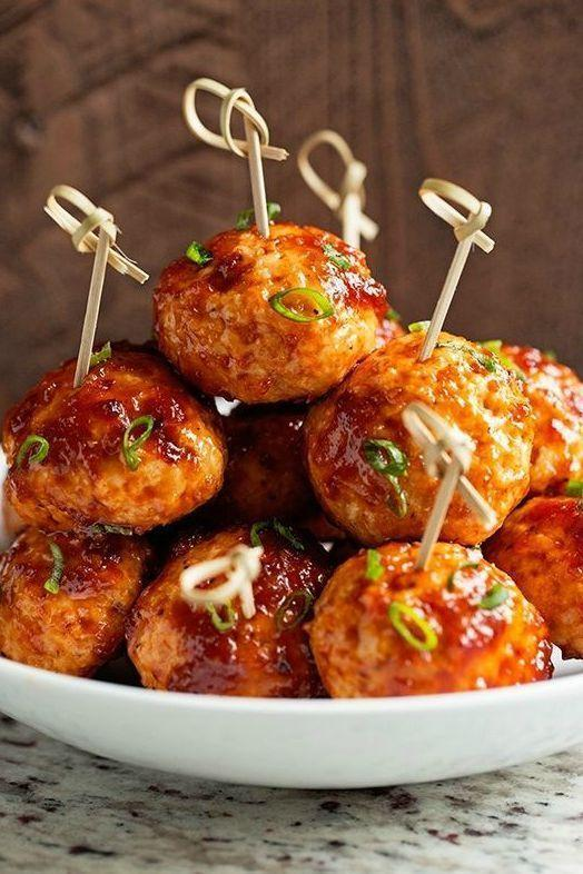 """<p>Smothered in a creamy homemade sauce, these chicken meatballs are an excellent way to kick off any party. Freshly grated ginger and pineapple juice are two of the winning ingredients here.</p><p><strong>Get the recipe at <a href=""""http://littlespicejar.com/hawaiian-bbq-chicken-meatballs/"""" rel=""""nofollow noopener"""" target=""""_blank"""" data-ylk=""""slk:Little Spice Jar"""" class=""""link rapid-noclick-resp"""">Little Spice Jar</a>.</strong></p><p><a class=""""link rapid-noclick-resp"""" href=""""https://go.redirectingat.com?id=74968X1596630&url=https%3A%2F%2Fwww.walmart.com%2Fsearch%2F%3Fcat_id%3D0%26facet%3Dbrand%253AThe%2BPioneer%2BWoman%26query%3Dthe%2Bpioneer%2Bwoman%2Bdisposable%2Bnapkins&sref=https%3A%2F%2Fwww.thepioneerwoman.com%2Ffood-cooking%2Fmeals-menus%2Fg36004463%2Fmemorial-day-appetizers%2F"""" rel=""""nofollow noopener"""" target=""""_blank"""" data-ylk=""""slk:SHOP DISPOSABLE NAPKINS""""><strong>SHOP DISPOSABLE NAPKINS</strong></a></p>"""