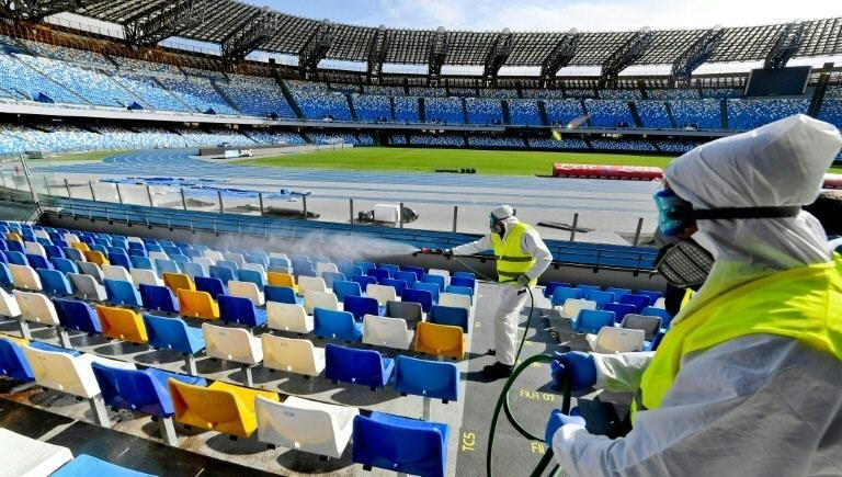 Napoli's San Paolo Stadium is disinfected on March 4. (AFP Photo/CIRO FUSCO)