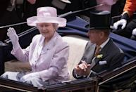 A regular event in the couple's calendar, the Queen and Duke of Edinburgh arrive at Royal Ascot to watch the first day of the annual race. (JOHN STILLWELL/AFP via Getty Images)