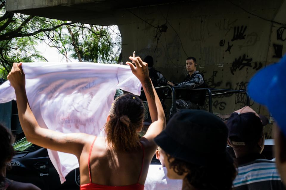 People are seen demonstrating against a military police of the state of Rio de Janeiro, Brazil, on January 4, 2021 in the neighborhood of Cidade de Deus, west zone of the city of Rio de Janeiro, act occurred due to the death of an identified resident like Marcelo Guimarães, 38 years old, who passed by motorcycle at the moment when police and drug dealers were in the conflict, this morning. (Photo by Allan Carvalho/NurPhoto via Getty Images)