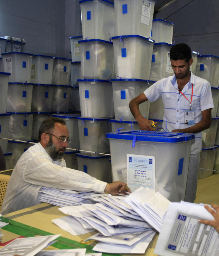 Electoral workers count ballots at a counting center in Baghdad, Iraq, Sunday, April 21, 2013. Iraqis have begun counting votes from the first provincial elections since the last U.S. troops withdrew in December 2011. (AP Photo/ Karim Kadim)
