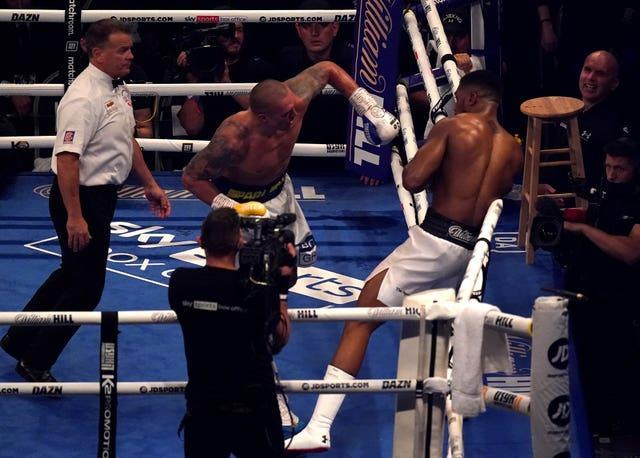 Anthony Joshua, right, ended the fight slumped in the ropes (Nick Potts/PA)