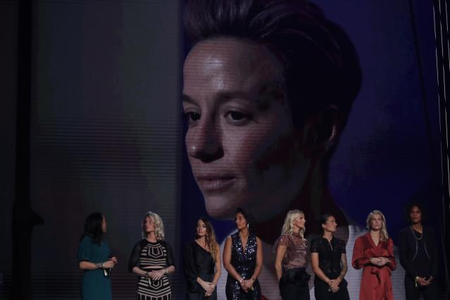 US Megan Rapinoe is seen on the screen after she awarded as the best female soccer player during the Golden Ball award ceremony at the Grand Palais in Paris, Monday, Dec. 2, 2019. Awarded every year by France Football magazine since Stanley Matthews won it in 1956, the Ballon d'Or, Golden Ball for the best player of the year will be given to both a woman and a man. (AP Photo/Francois Mori)