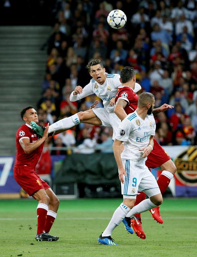 Soccer Football - Champions League Final - Real Madrid v Liverpool - NSC Olympic Stadium, Kiev, Ukraine - May 26, 2018 Real Madrid's Cristiano Ronaldo heads at goal before Karim Benzema scored a goal from the rebound which was subsequently disallowed for offside REUTERS/Gleb Garanich TPX IMAGES OF THE DAY