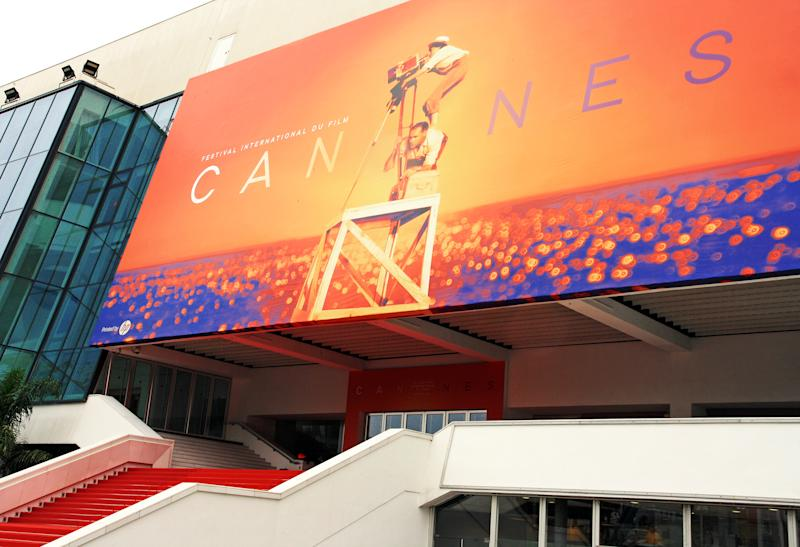 Cannes, France - May 27, 2019: official poster of the 72nd International Film Festival on the facade of the Palais des Festivals and Congress.