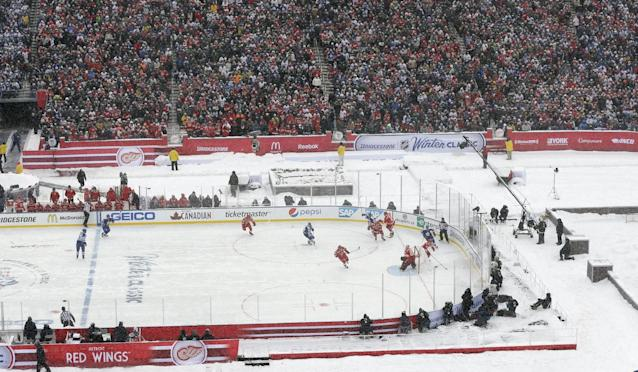 The Toronto Maple Leafs and the Detroit Red Wings play during the first period of the Winter Classic outdoor NHL hockey game at Michigan Stadium in Ann Arbor, Mich., Wednesday, Jan. 1, 2014. (AP Photo/Carlos Osorio)