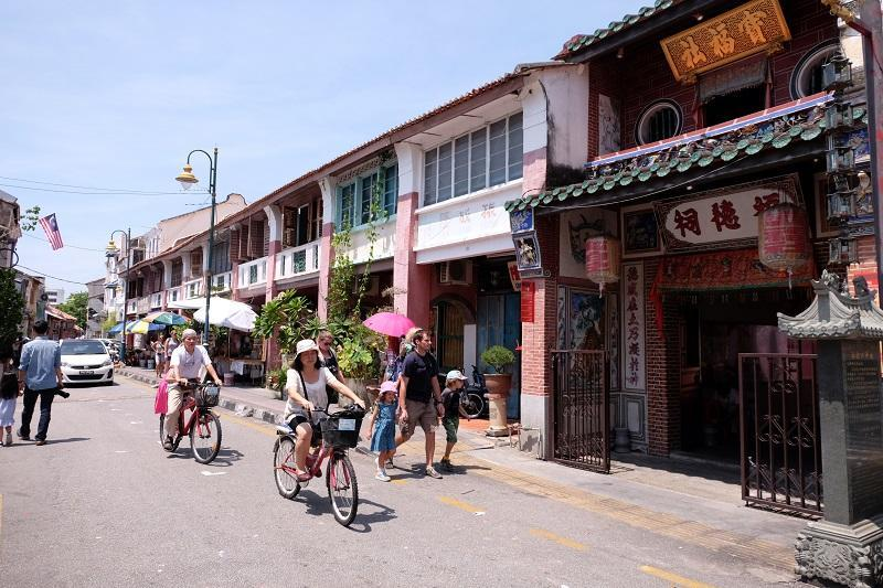 Tourists are seen riding their bicycles along the streets of George Town. With the MCO, it has made the tourism sector among the worst hit sectors of Malaysia's economy. — File picture by KE Ooi