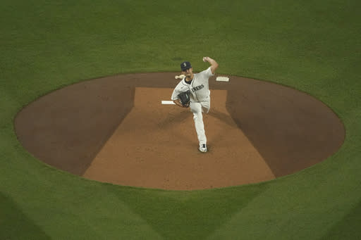 Seattle Mariners starting pitcher Marco Gonzales throws against the Oakland Athletics during the first inning of the first baseball game of a doubleheader, Monday, Sept. 14, 2020, in Seattle. (AP Photo/Ted S. Warren)