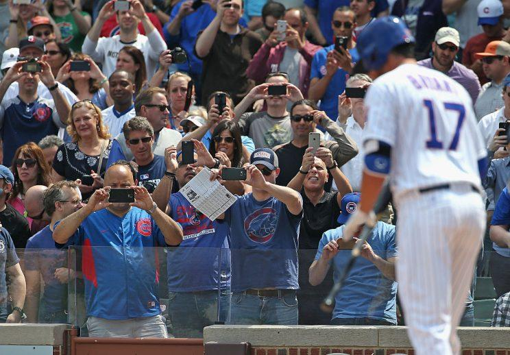 CHICAGO, IL - APRIL 17: Fans take cell phone phtographs before Kris Bryant #17 of the Chicago Cubs has his first Major League at-bat against the San Diego Padres at Wrigley Field on April 17, 2015 in Chicago, Illinois. (Photo by Jonathan Daniel/Getty Images)