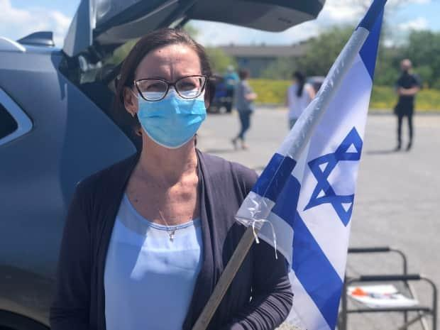 Bella Kravtzov helped organize Sunday's rally, and says its purpose was to show 'solidarity, unity, support to the Israeli people.'