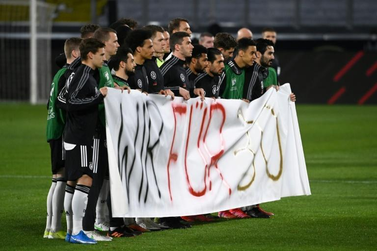 """Protest: German players hold up a banner """"We for 30"""""""