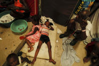 A boy lies on pieces of foam at a shelter for displaced Haitians, in Port-au-Prince, Haiti, Saturday, July 10, 2021, three days after Haitian President Jovenel Moise was assassinated in his home. The displaced Haitians were forced to flee their community where they had settled after the 2010 earthquake, after armed gangs set their homes on fire in late June. (AP Photo/Fernando Llano)