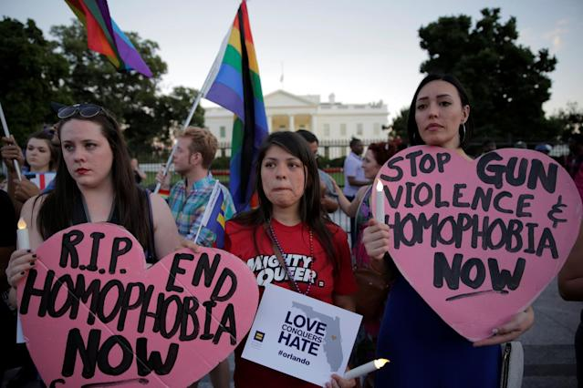 <p>People hold a vigil in front of the White House, June 12, 2016. (Joshua Roberts/Reuters) </p>