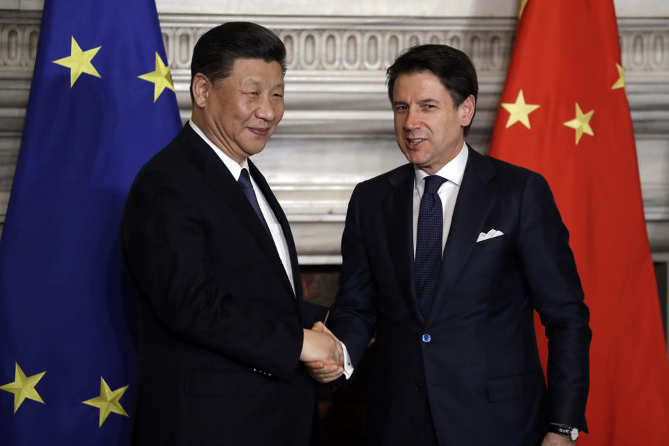 """Chinese President Xi Jinping, left, and Italian Premier Giuseppe Conte shake their hands at the end of the signing ceremony of a memorandum of understanding at Rome's Villa Madama, Saturday, March 23, 2019. Italy signed a memorandum of understanding with China on Saturday in support of Beijing's """"Belt and Road"""" initiative, which aims to weave a network of ports, bridges and power plants linking China with Africa, Europe and beyond. (AP Photo/Andrew Medichini)"""