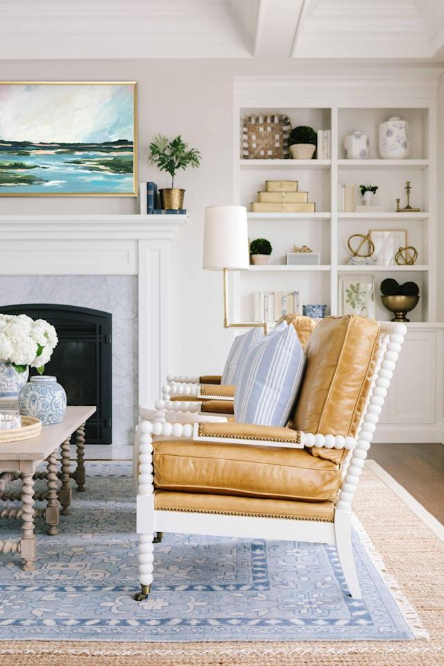 """<p>Rich caramel leather isn't just for dark, somber studies—in a family room designed by <a href=""""https://www.housebeautiful.com/design-inspiration/house-tours/a27114539/bria-hammel-home-tour/"""" target=""""_blank"""">Bria Hammel</a>, it's gorgeous paired with cornflower blue.</p>"""
