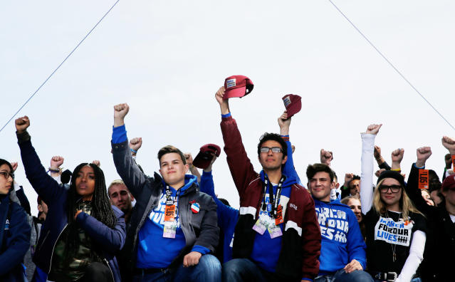 "Students and school shooting survivors hold their fists and hats aloft in solidarity at the conclusion of the ""March for Our Lives"" event demanding gun control after recent school shootings at a rally in Washington, U.S., March 24, 2018. (Photo: Jonathan Ernst/Reuters)"