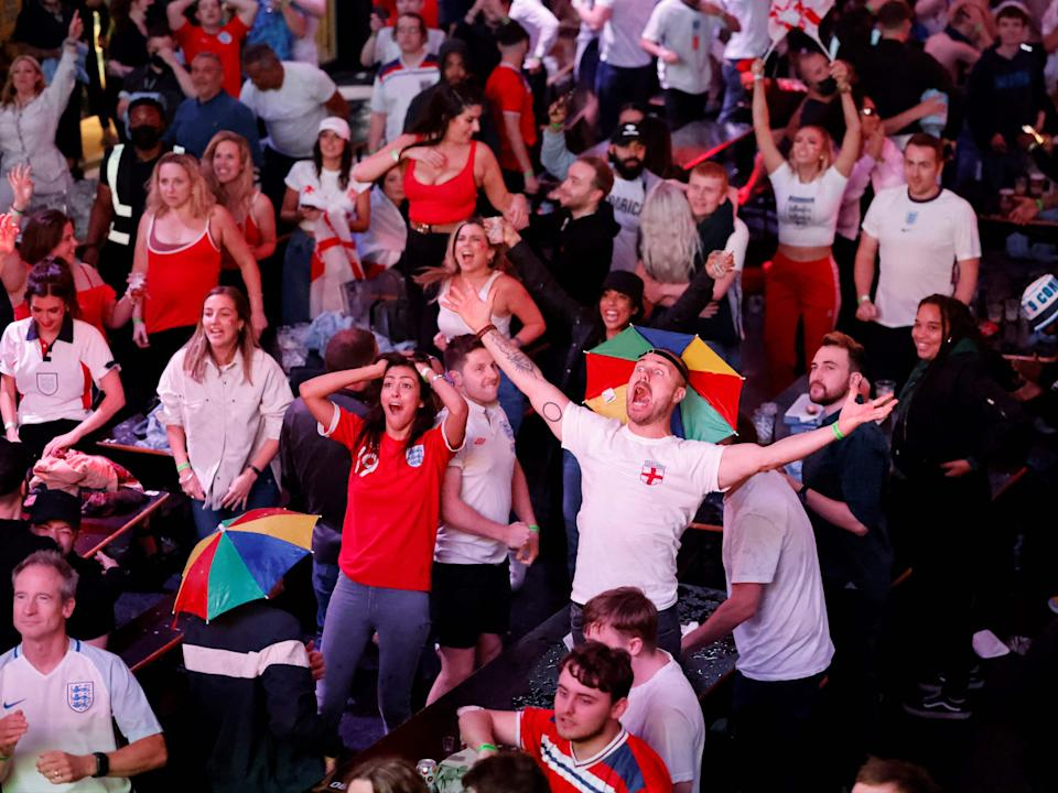 England supporters celebrate England's penalty and second goal as they watch the UEFA EURO 2020 semi-final football match  (AFP via Getty Images)