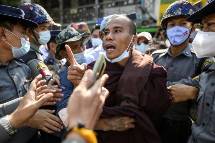 Police detain a Buddhist monk while he takes part in a protest in support of the jailed nationalist right wing monk Wirathu outside Insein prison in Yangon