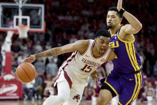 Arkansas guard Mason Jones(15) drives past LSU defender Skylar Mays (4) during the first half of an NCAA college basketball game Wednesday, March 4, 2020, in Fayetteville, Ark. (AP Photo/Michael Woods)