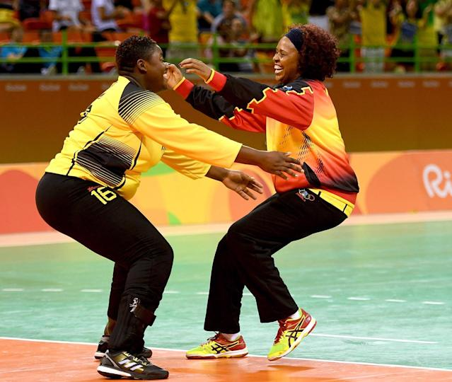 <p>Teresa Patrica Alemida of Angola celebrates after the Women's Handball match between Romania and Angola on Day 1 of the Rio 2016 Olympic Games at Future Arena on August 6, 2016 in Rio de Janeiro, Brazil. (Photo by Ross Kinnaird/Getty Images) </p>