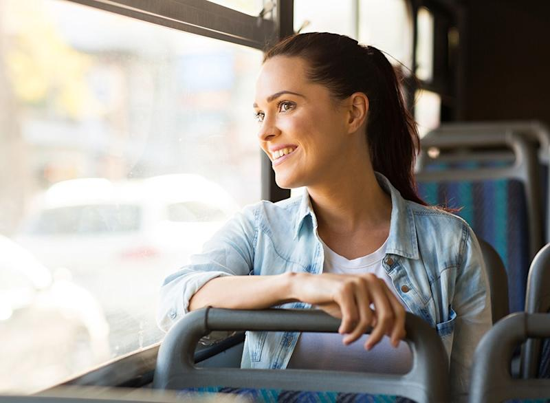 Woman on bus commuting