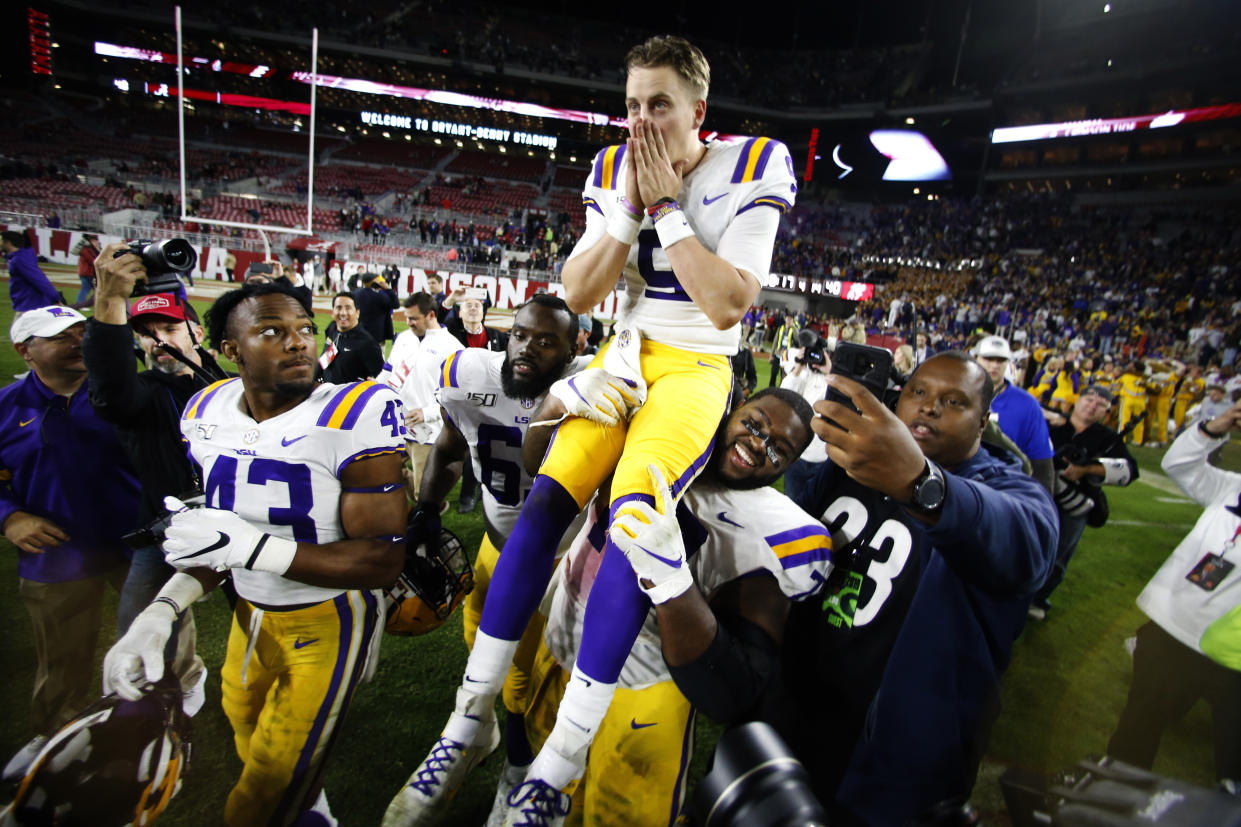 LSU quarterback Joe Burrow (9) is carried off the field by his teammates after defeating Alabama 46-41 on Saturday. (AP)