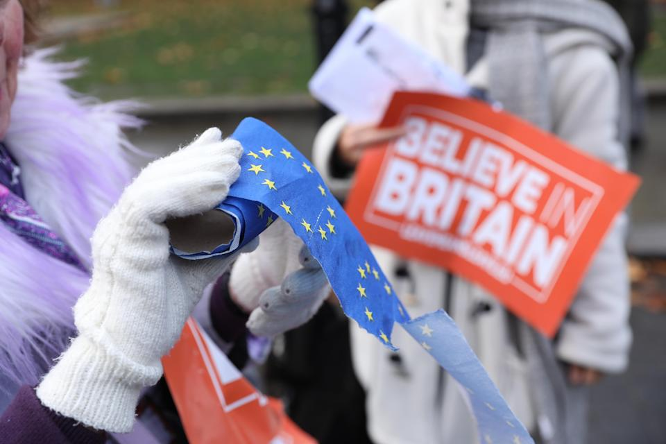 A Leave protestor holds an EU toilet roll. Photo: Isabel Infantes/EMPICS Entertainment