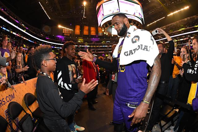 """<a class=""""link rapid-noclick-resp"""" href=""""/nba/players/3704/"""" data-ylk=""""slk:LeBron James"""">LeBron James</a> had just the right words to say to his son, Bryce, after Bryce's team staged a comeback win. (Photo by Andrew D. Bernstein/NBAE via Getty Images)"""
