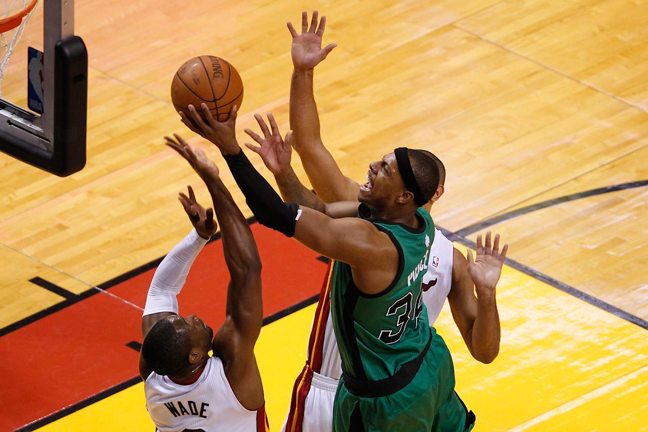 MIAMI, FL - MAY 28:  Paul Pierce #34 of the Boston Celtics drives for a shot attempt in the first half against Dwyane Wade #3 of the Miami Heat in Game One of the Eastern Conference Finals in the 2012 NBA Playoffs on May 28, 2012 at American Airlines Arena in Miami, Florida.  NOTE TO USER: User expressly acknowledges and agrees that, by downloading and or using this photograph, User is consenting to the terms and conditions of the Getty Images License Agreement.  (Photo by J. Meric/Getty Images)