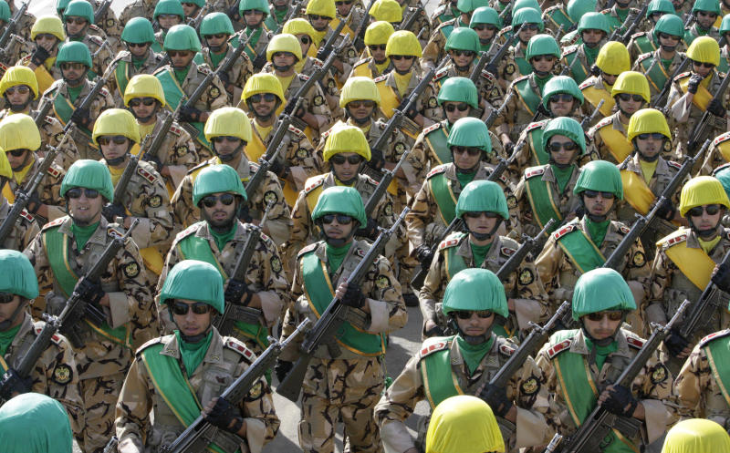 Iranian troops march during a military parade commemorating National Army Day in front of the mausoleum of the late revolutionary founder Ayatollah Khomeini, outside Tehran, Iran, Tuesday, April 17, 2012. (AP Photo/Vahid Salemi)