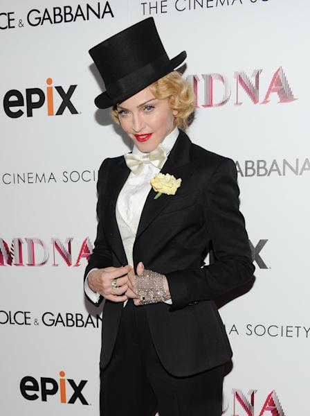 "Madonna attends the world premiere of ""Madonna: The MDNA Tour"" at the Paris Theatre on Tuesday, June 18, 2013 in New York. (Photo by Evan Agostini/Invision/AP)"