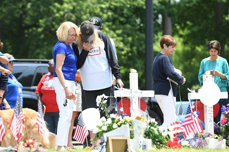 People stop by the memorial at the Municipal Center to pay their respects on June 3, 2019, for the victims of the mass in Virginia Beach, Va.