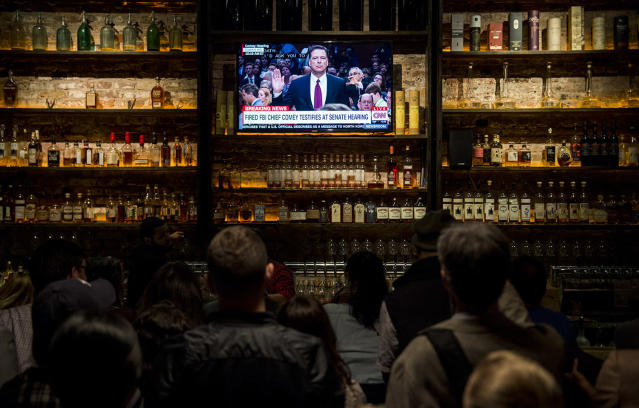 <p>The crowd gathered at The Partisan bar Comey watch party in Washington watch as former FBI Director James Comey arrives to testify during the Senate Select Intelligence Committee hearing on June 8, 2017. (Bill Clark/CQ Roll Call) </p>