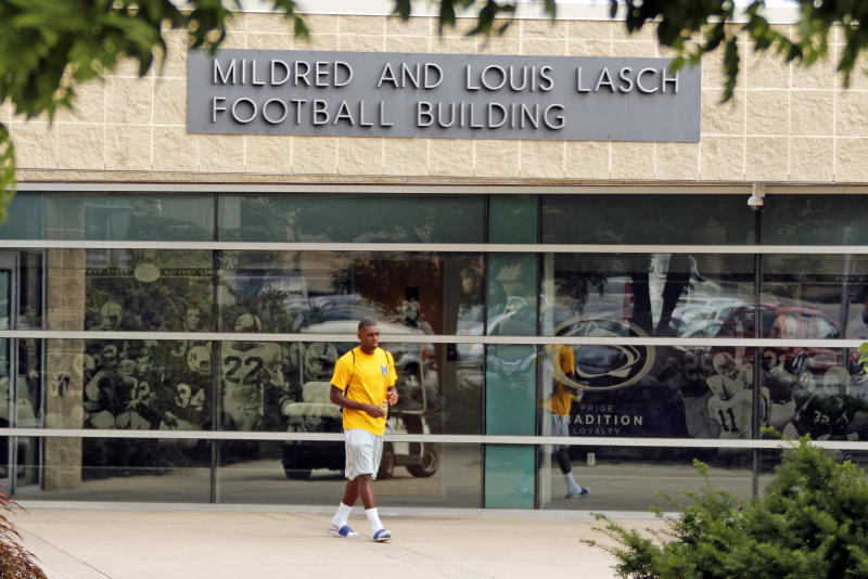 FILE - In this July 12, 2012 file photo, a Penn State student leaves the Mildred and Louis Lasch Football Building on the Penn State University main campus in State College, Pa. After and eight-month inquiry, Former FBI director Louis Freeh's firm produced a 267-page report that concluded that Paterno and other top Penn State officials hushed up child sex abuse allegations against former Penn State assistant football coach Jerry Sandusky for more than a decade for fear of bad publicity, allowing Sandusky to prey on other youngsters. (AP Photo/Gene J. Puskar, File)