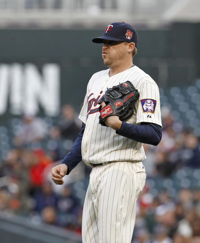 Minnesota Twins starting pitcher Kevin Correia reacts after giving up a double to Boston Red Sox designated hitter David Ortiz during the first inning of a baseball game in Minneapolis, Wednesday, May 14, 2014. (AP Photo/Ann Heisenfelt)