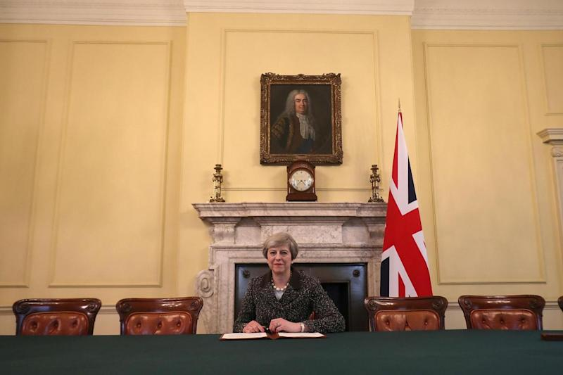Theresa May in the cabinet office sitting below a painting of Britain's first PM Robert Walpole. (REUTERS)