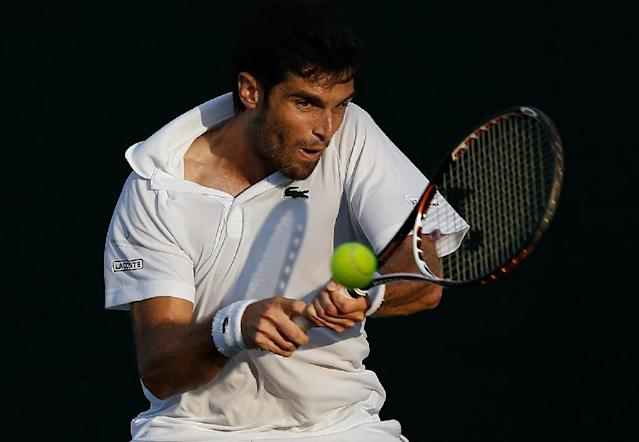 Clay day: Pablo Andujar downed Kyle Edmund to win the Marrakech clay court title on Sunday (AFP Photo/ADRIAN DENNIS)
