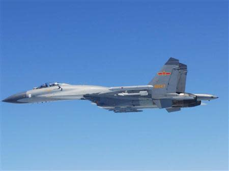 Chinese SU-27 fighter flies over the East China Sea