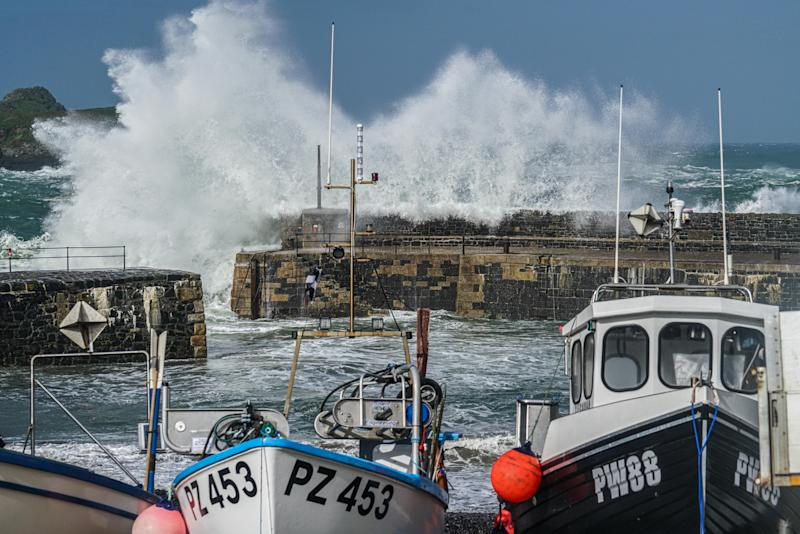 MULLION COVE, CORNWALL - AUGUST 21: Waves cased by Storm Ellen strike the National Trust-owned harbour on August 21, 2020 at Mullion Cove, Cornwall, United Kingdom. The Met Office extended a weather warning for a further twenty-four hours as Storm Ellen continued to blow. (Photo by Hugh R Hastings/Getty Images)