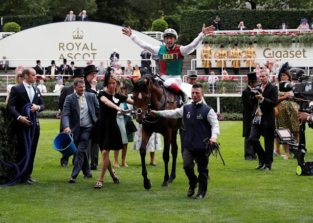 Horse Racing - Royal Ascot - Ascot Racecourse, Ascot, Britain - June 19, 2018 Frankie Dettori jumps off Without Parole as he celebrates winning the 4.20 St James's Palace Stakes Action Images via Reuters/Paul Childs