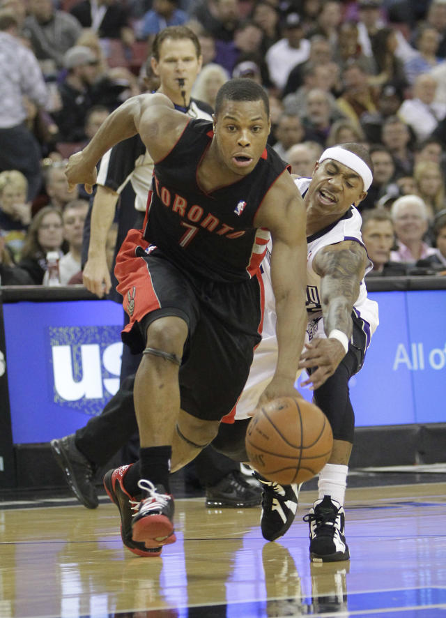 Toronto Raptors guar Kyle Lowry, left, eludes the steal attempt of Sacramento Kings guard Isaiah Thomas during the first quarter of an NBA basketball game in Sacramento, Calif., Wednesday, Feb. 5, 2014. (AP Photo/Rich Pedroncelli)