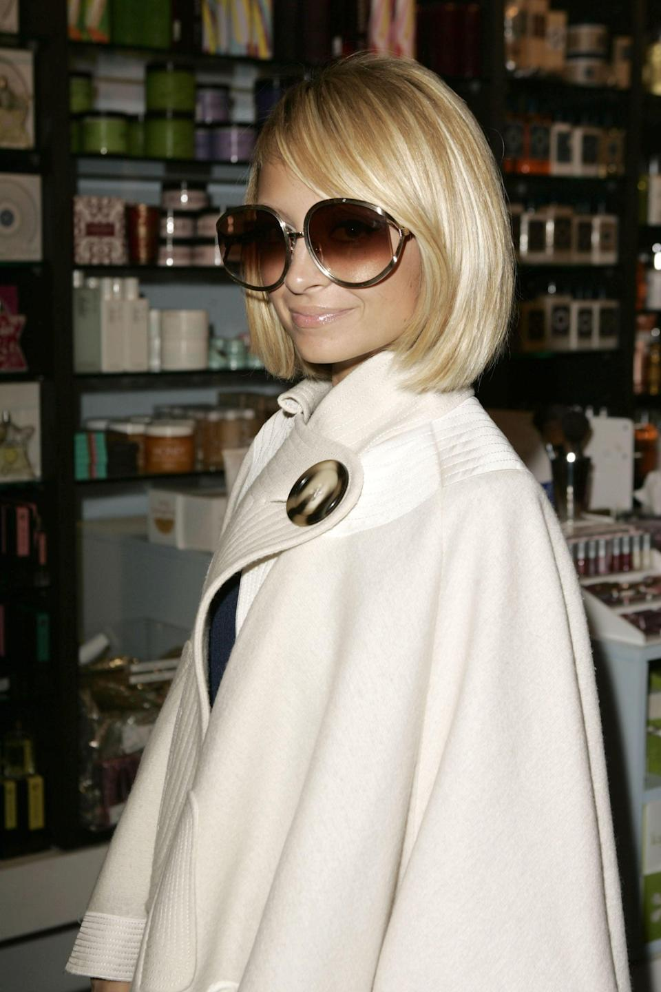 """<p>Cape coats are back, and they're better than ever. <a class=""""link rapid-noclick-resp"""" href=""""https://www.popsugar.com/Nicole-Richie"""" rel=""""nofollow noopener"""" target=""""_blank"""" data-ylk=""""slk:Nicole Richie"""">Nicole Richie</a> wore a heavy woolen style with a single button back in 2005, and the 2019 versions come in tweed, leopard print, and classic shades of camel, as well as cape-trench hybrids.</p>"""