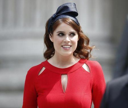 Britain's Princess Eugenie leaves after a service of thanksgiving for Queen Elizabeth's 90th birthday at St Paul's Cathedral in London