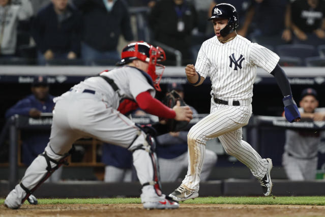 "Boston Red Sox catcher <a class=""link rapid-noclick-resp"" href=""/mlb/players/9762/"" data-ylk=""slk:Christian Vazquez"">Christian Vazquez</a> (7) waits for the throw as New York Yankees' Gleyber Torres, right, heads home to score on Brett Gardner's two-run triple during the eighth inning of a baseball game in New York, Wednesday, May 9, 2018. (AP)"