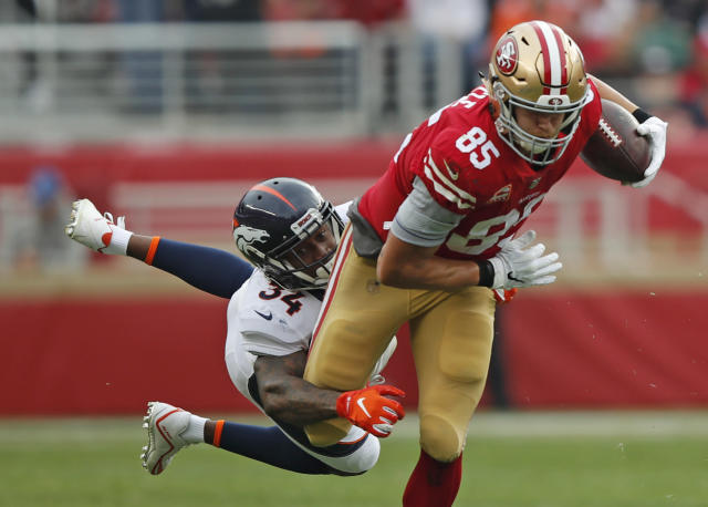 <p>San Francisco 49ers tight end George Kittle (85) runs with the ball away from Denver Broncos strong safety Will Parks (34) during the first half of an NFL football game Sunday, Dec. 9, 2018, in Santa Clara, Calif. (AP Photo/John Hefti) </p>