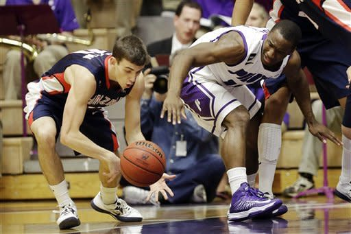 Gonzaga guard David Stockton, left, steals the ball from Portland guard Derrick Rodgers during the first half of an NCAA college basketball game in Portland, Ore., Thursday, Jan. 17, 2013. (AP Photo/Don Ryan)