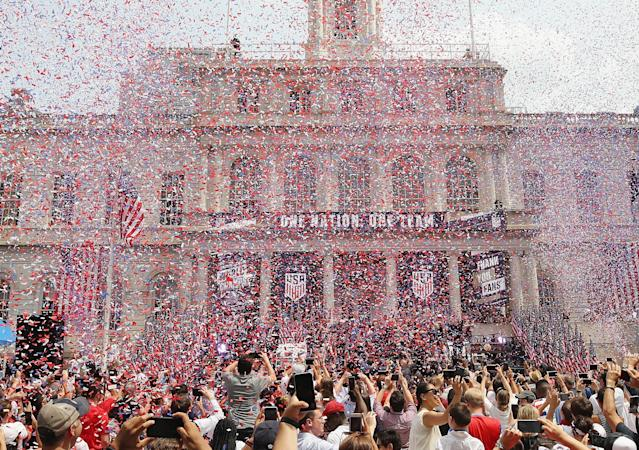 """Members of the United States Women's National Soccer Team are honored at a ceremony at City Hall on July 10, 2019 in New York City. The honor followed a ticker tape parade up lower Manhattan's """"Canyon of Heroes"""" to celebrate their gold medal victory in the 2019 Women's World Cup in France. (Photo by Bruce Bennett/Getty Images)"""