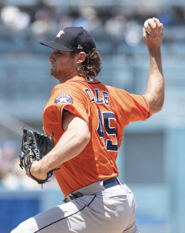 Houston Astros starting pitcher Gerrit Cole delivers a pitch during the first inning of a baseball game against the Los Angeles Dodgers in Los Angeles, Sunday, Aug. 5, 2018. (AP Photo/Kyusung Gong)