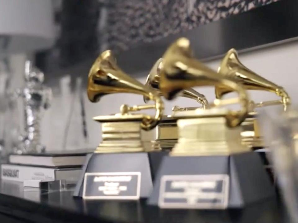 """Grammy trophies on a table on HBO Max's """"Gossip Girl."""""""